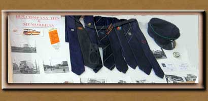 Display case showing hats and ties worn by bus drivers