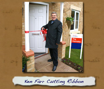 Ken Farr cutting ribbon to showhouse